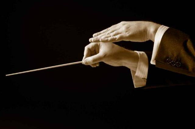 Italian conductor hands with baton- Tuscan Weddings and Events